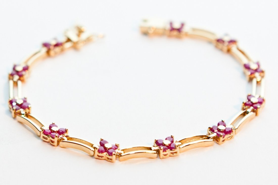 3: Genuine 11 CT Cabochon Ruby Floral Bracelet