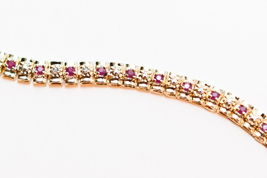 9: 1.83 CTW Diamond and Ruby Tennis Bracelet