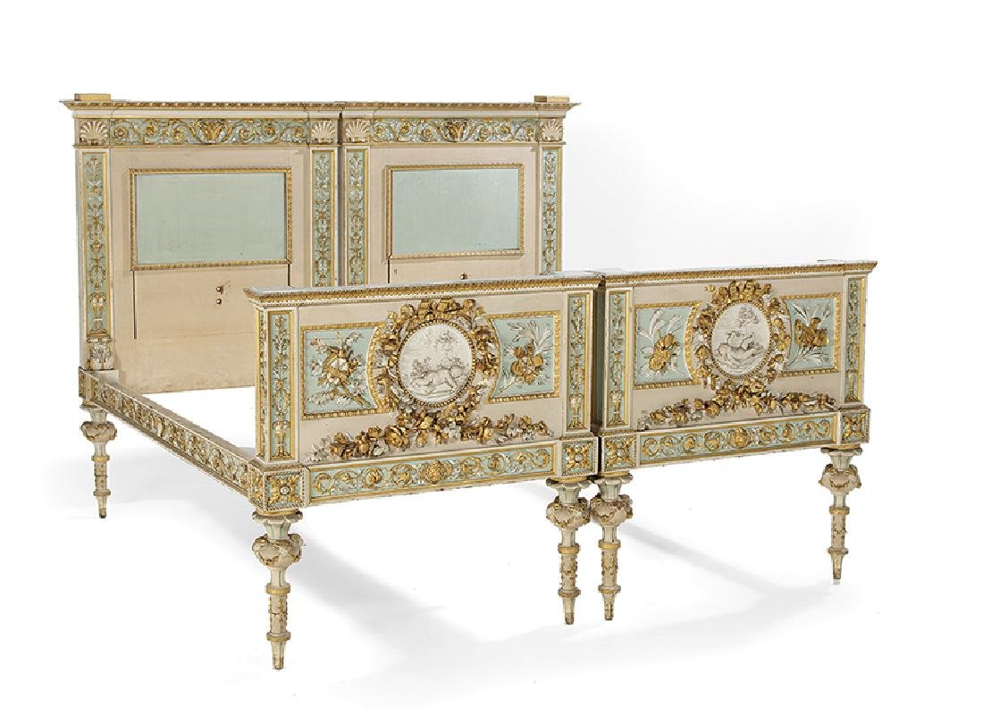 Pair of Italian Creme-Peinte and Parcel-Gilt Beds