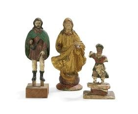 Three Carved, Painted and Gilded Santos Figures