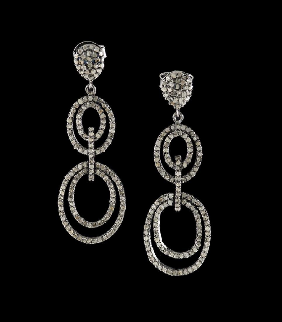 Pair of Silver and Diamond Dangle Earrings
