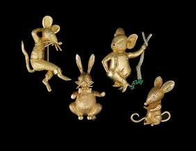 Suite of Four 18/14 Kt. Gold Brooches