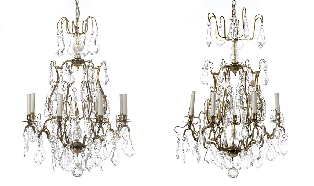 Near Pair of French Bronze and Crystal Chandeliers
