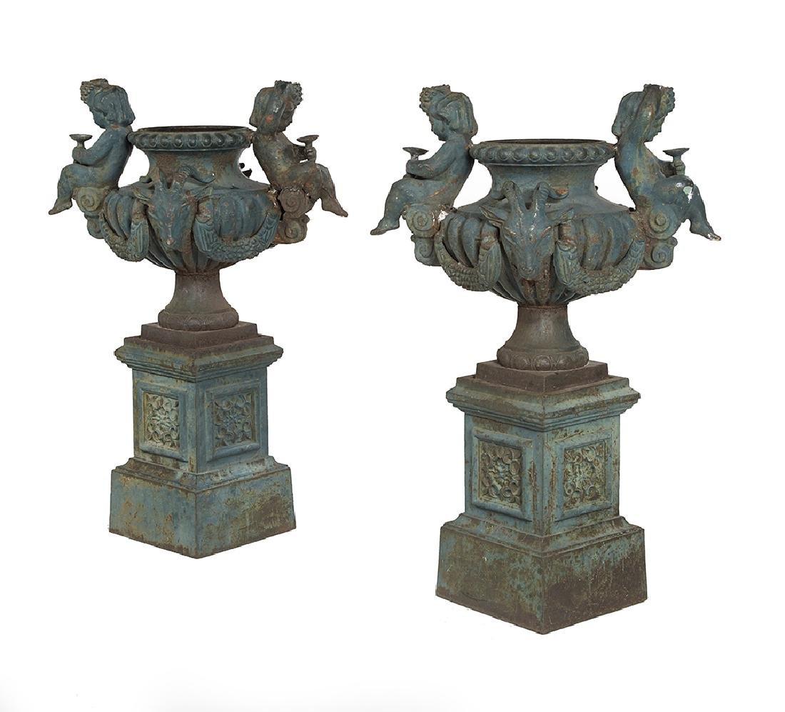 Pair of Exuberantly Modeled Cast Iron Garden Urns on