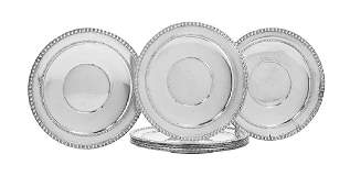 Eight Sterling Silver Service Plates