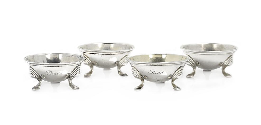 Assembled Set of Four Coin Silver Salt Cellars