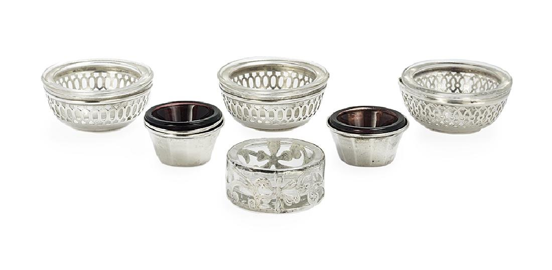 Seven Small American Silver and Glass Salt Cellars