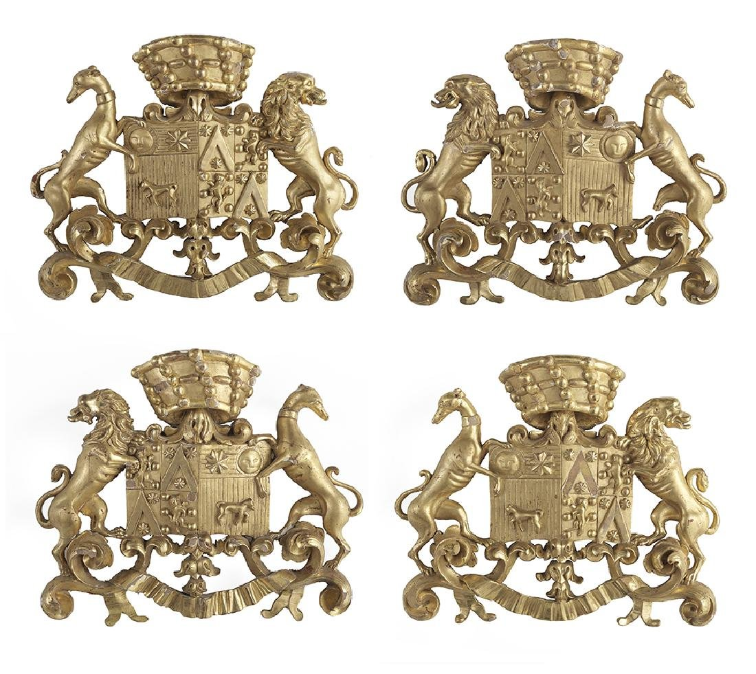 Set of Four Carved Giltwood Armorial Wall Plaques
