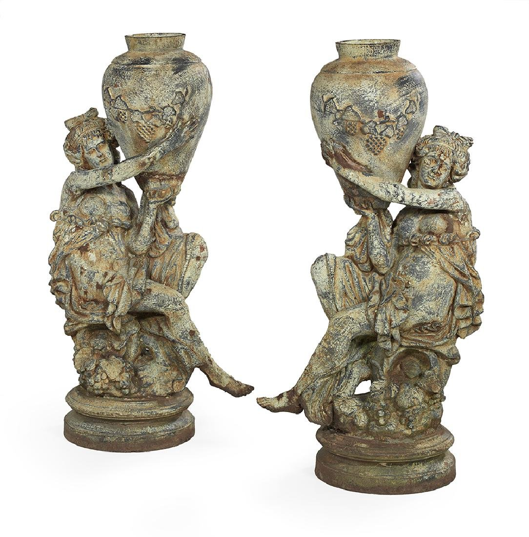 Pair of Cast Iron Figural Urns