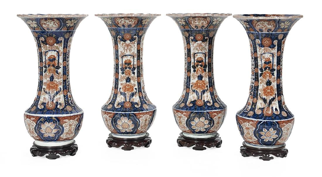 Four Large Imari Vases with Hardwood Stands