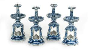 Four Chinese Blue and White Pricket Candlesticks
