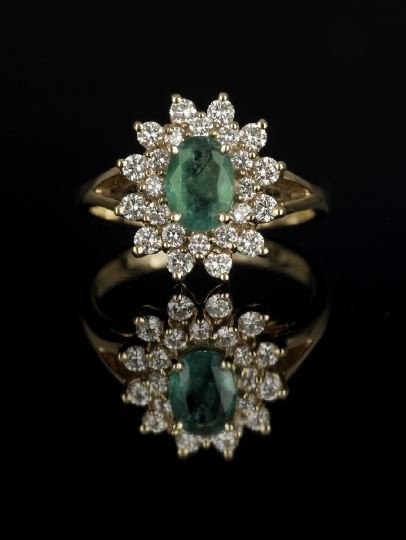 642: 18 Kt Yellow Gold, Emerald and Diamond Ring