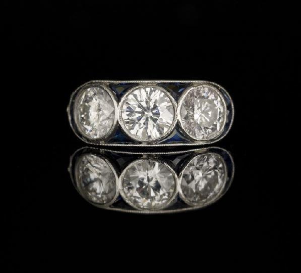 647: Art Deco 18 Kt White Gold Three Diamond Ring