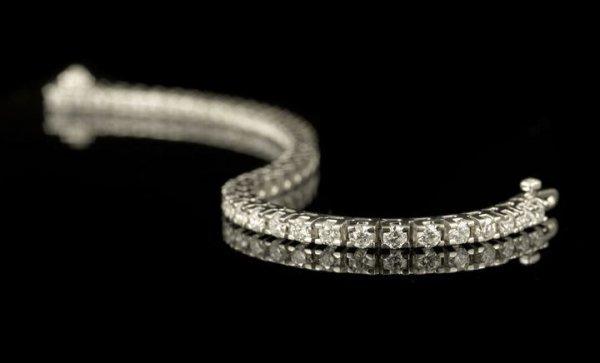"561: 18 Kt. and Diamond Flexible ""Tennis"" Bracelet"