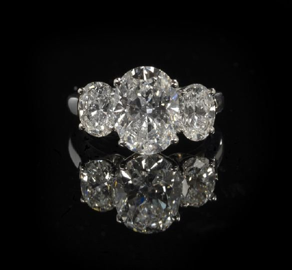 721: Platinum and Three-Stone Diamond Lady's Ring