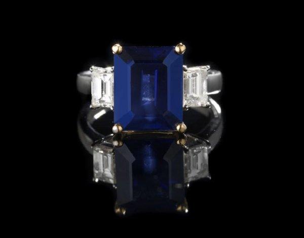 668: Platinum, 18 Kt. Gold, Sapphire and Diamond Ring