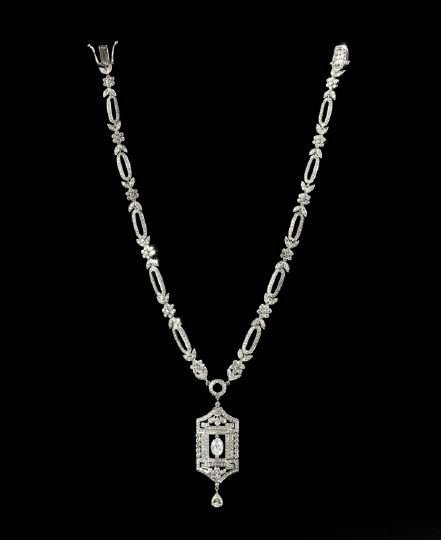 715: 18 Kt. Gold and Diamond Art Deco Pendant Necklace