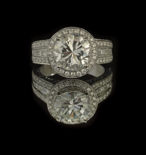 716: 18 Kt. White Gold and Diamond Lady's Ring