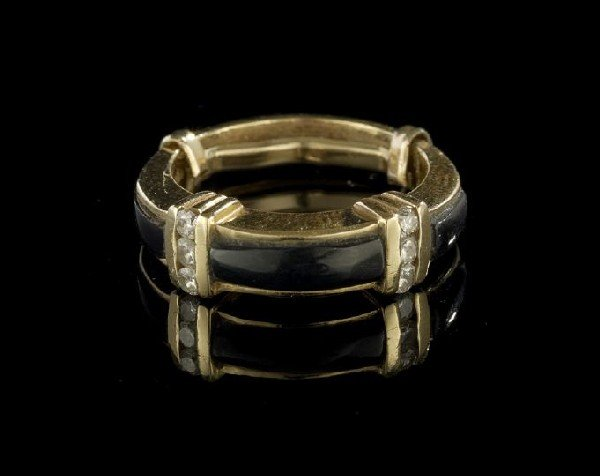 687: 18 Kt., Onyx and Diamond Band Ring