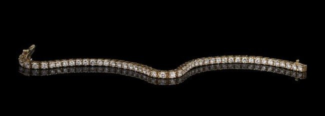 756: Lady's 18 Kt. Yellow Gold and Diamond Bracelet
