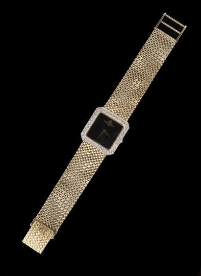 836: 14 Kt.Gold and Diamond Baume & Mercier Wristwatch