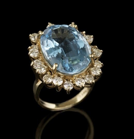 849: 14 Kt. Gold, Blue Topaz and Diamond Dinner Ring