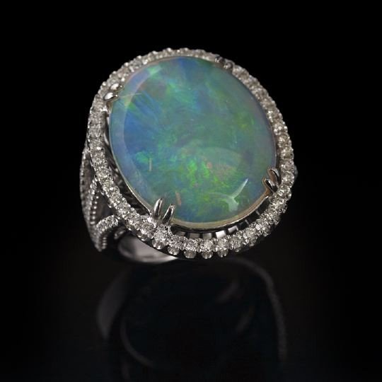 853: 18 Kt. Gold, Opal and Diamond Lady's Dinner Ring
