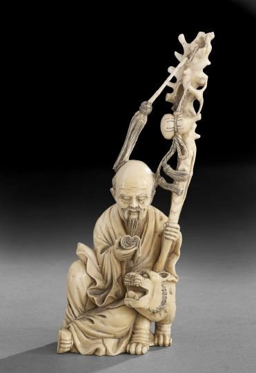 762: Chinese Carved Ivory Scholar with a Foo Lion