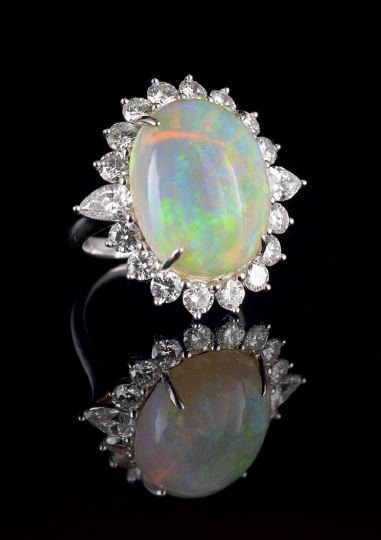 1126: Lady's Platinum Opal and Diamond Ring
