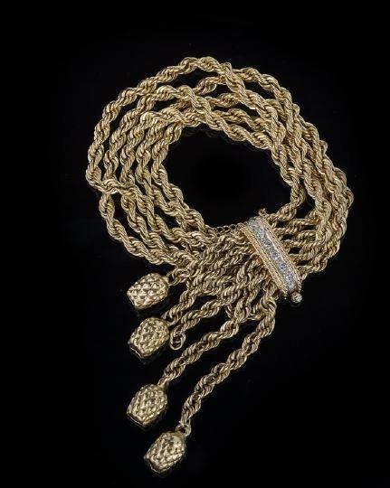 832: Lady's 14 Karat Yellow Gold and Diamond Bracelet