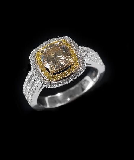 1165: 18 Kt. Yellow and White Gold Diamond Ring