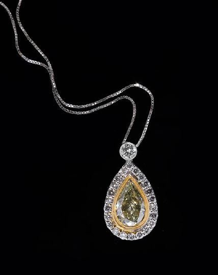 1169: Lady's 18 Kt. Gold and Diamond Pendant with Chain