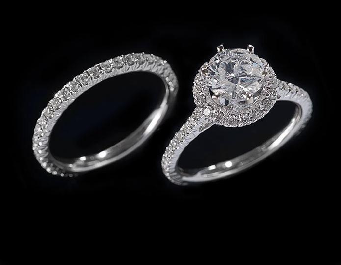 1175: 18 Kt. White Gold and Diamond Wedding Set