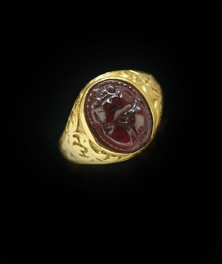 1179: Lady's 18 Kt. Yellow Gold and Garnet Ring