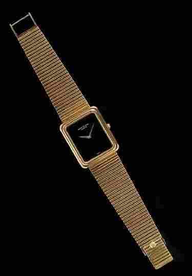 1186: Men's 18 Kt. Gold Patek Philippe Geneve Watch