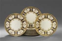 Twelve Royal Doulton Raised Gilt Service Plates