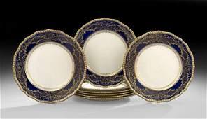 Eight Royal Doulton Raised Gilt Service Plates