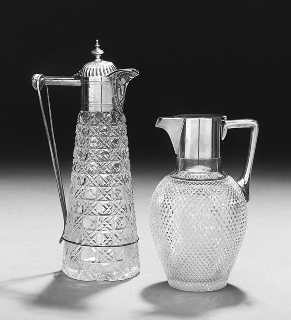 Two Victorian Sterling-Mounted Glass Claret Jugs
