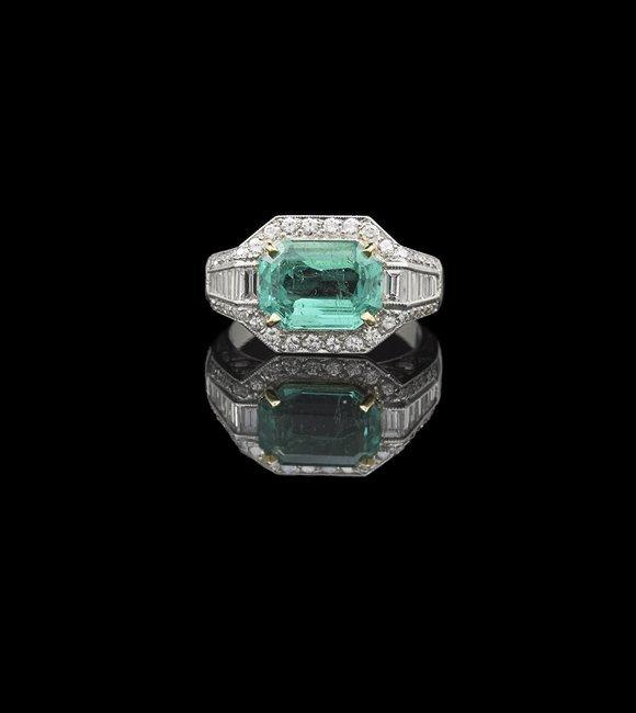 Platinum, 18 Kt. Gold, Emerald and Diamond Ring