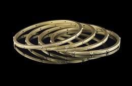 Four 18 Kt. Gold and Diamond Bangle Bracelets