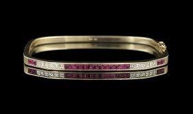 14 Kt. Gold, Ruby and Diamond Bangle Bracelet