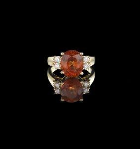 14 Kt. Gold, Spessartite Garnet and Diamond Ring