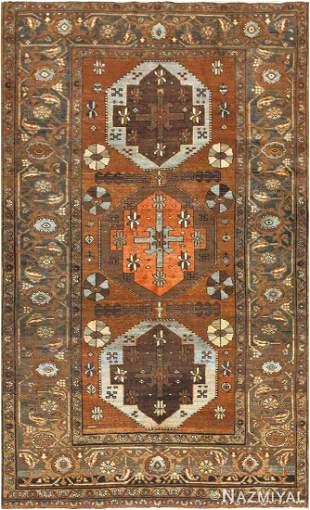 ANTIQUE TRIBAL PERSIAN HERIZ RUG.