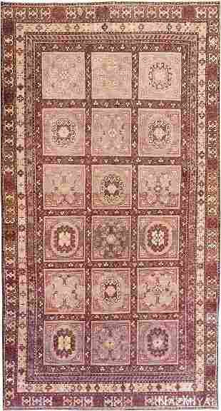 ANTIQUE KHOTAN RUG.
