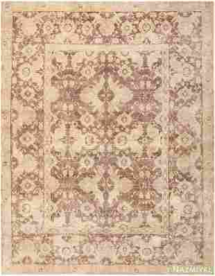 ANTIQUE SOFT AND MUTED INDIAN AGRA CARPET.