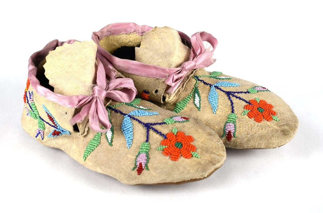 """Pair of 9 5/8"""" Sioux Moccasins"""