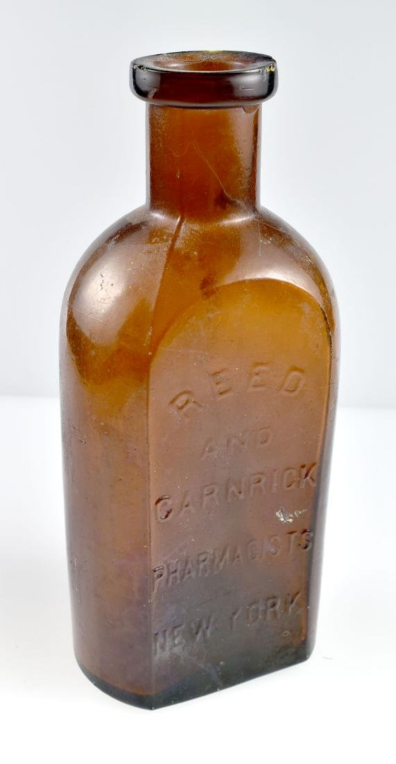 Reed and Carnrick Pharmacists Bottle