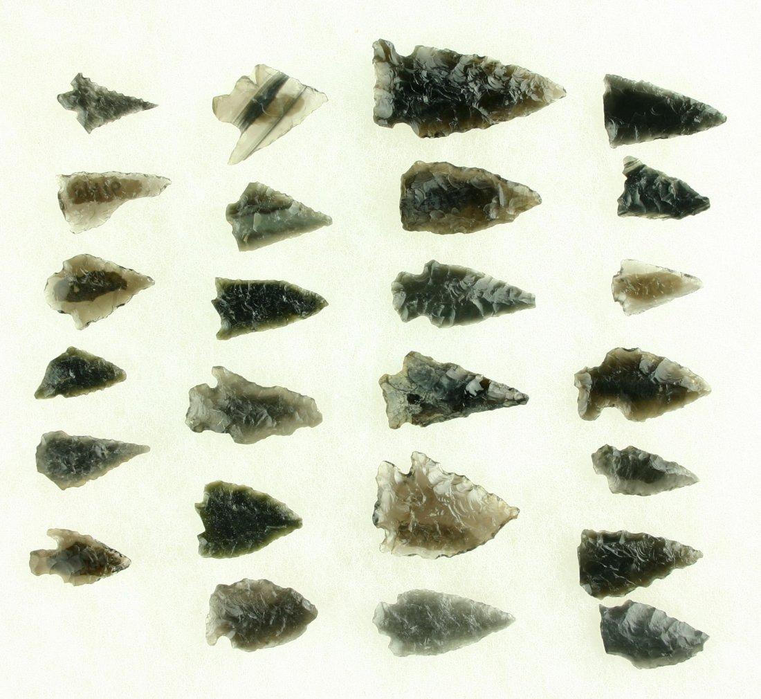 92: 25 Translucent Obsidian Arrowheads