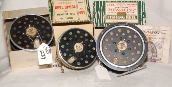 239: Nice lot of Pflueger Reel & Spools.  We have a Pfl