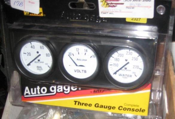 """Autometer 2"""" Mechanical #2327 3 gauge console oil, volt"""
